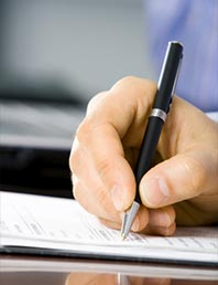 Person signing a document.