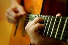 Classical_Guitar_player.12103559